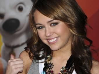 Miley Cyrus Riendose.